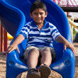 Portrait of a cute little indian boy at playground — Stock Photo