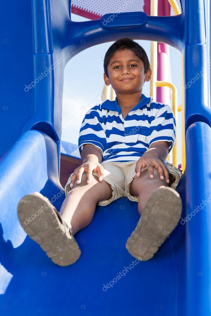Outdoor portrait of a cute little indian boy at playground — Stock Photo #12738618