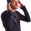Young african american man listening to music — Stock Photo #13893443