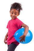 Cute young African American girl holding a blue balloon — Stock Photo