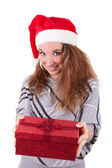 Young caucasian woman offering a gift — Stock Photo