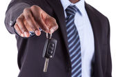 Young African American businessman holding a car key — Stock Photo