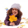 Little african asian girl wearing winter clothes playing with le — Stock Photo #16570433