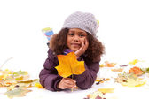 Little african asian girl wearing winter clothes playing with le — Stock Photo