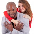 Portrait of a young happy mixed couple — Stock Photo