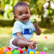 Little african american baby boy playing in the grass — Stock Photo