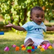Little african american baby boy playing in the grass — Stock Photo #17865991