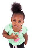 Cute little african american girl looking up — Stock Photo