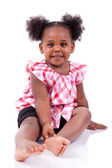 Cute little african american girl laughing — Stock Photo