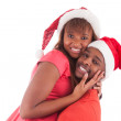 Young african american couple wearing santa hat — Stock Photo