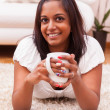 Young beautiful indian woman drinking coffee — Stock Photo