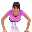 Young beautiful caucasian fitness woman doing push up exercises — Stock Photo