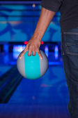 African hand holding a bowling ball — Stock Photo