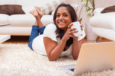 Young happy indian woman using a laptop — Stock Photo