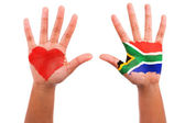 African hands with a painted heart and south african flag, i lov — Stock Photo