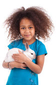 African Asian girl holding a rabbit — Stock Photo