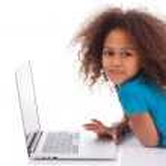 Little african asian girl using a laptop — Stock Photo