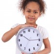 Little african asian girl holding a clock — Stock Photo #22126653