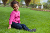 Portrait of a Adorable little African Asian girl seated on the — Stock Photo