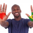 Brazilian man hands with a painted heart and brazilian flag, i — Stock Photo
