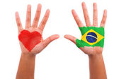 Brazilian hands with a painted heart and brazilian flag, i love — Stock Photo