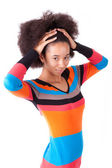 Black African American teenage girl holding her afro hair — Stock Photo