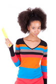 Black African American teenage girl combing her afro hair — Stock Photo