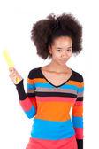 Black African American teenage girl combing her afro hair — Stock Photo