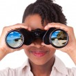 Young black african american business woman using binoculars l — Stock Photo