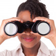 Young black african american business woman using binoculars — Stock Photo #23704249