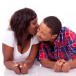 Happy young black African American couple lying down on the floo — Stock Photo #23969979