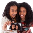 Young black african american teenage girls taking pictures with — Stockfoto