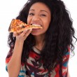 Young black african american teenage girl eating a slice of pizz — Stok fotoğraf
