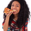 Stock Photo: Young black african american teenage girl eating a slice of pizz