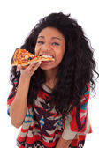 Young black african american teenage girl eating a slice of pizz — Stock Photo