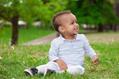 Portrait of a black african american baby boy playing in the pa — Stock Photo