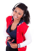 Young black African American teenage girl listening to music - — Stock Photo