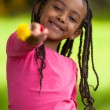 Outdoor portrait of a cute young black girl - African — Stock Photo #25086951