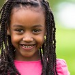 Outdoor close up portrait of a cute young black girl - African p — Stock Photo #25087055