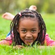 Outdoor portrait of a cute young black girl smiling - African pe — Stock Photo