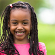 Outdoor close up portrait of a cute young black girl - African p — Stock Photo #25087091