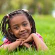 Outdoor portrait of a cute young black girl smiling - African pe — Stock Photo #25087109