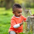 Outdoor portrait of a cute young little black boy playing outsi — Stock Photo #25087279
