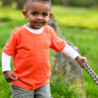 Outdoor portrait of a cute young little black boy playing outsi — Stock Photo #25087283
