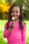 Outdoor portrait of a cute young black girl - African — Stock fotografie