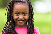 Outdoor close up portrait of a cute young black girl - African p — Stock Photo