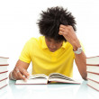 Young african american student reading books - African — Stock Photo #25489193