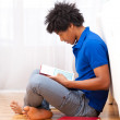 Young african american student reading books - African — Stock Photo #25489289