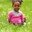 Outdoor close up portrait of a cute little young black girl - Af - Stock Photo