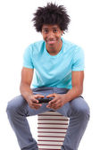 Young black teenage men playing video games - African — Stock Photo